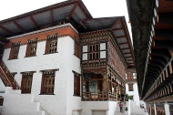 "The most imposing landmark in Thimphu—Trashi Chhoe Dzong which translates as ""Fortress of the Glorious Religion"". It contains the throne room and offices of the King of Bhutan, Central Secretariat, and the summer quarters of Bhutan's central monastic body."