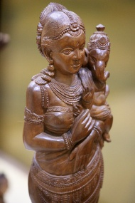 """Parvati and Ganesh, Sandal wood carving: The above """"European"""" pose was adapted from Christian concepts and was a popular subject with the sculpture students of Sir J.J. School of Art under the tutelage of British art experts."""