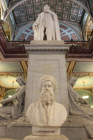 "The centrepiece of the museum is a towering statue of Prince Albert, Queen Victoria's consort, engraved with a dedication by David Sassoon (1864), and flanked by two muses. One muse holds a tablet titled ""Science"" and the other ""Art"" referring to the two curated themes of the Industrial Arts Gallery. A bust of Sassoon, who donated the tract of land on which the museum is built, stands at the foot of the statue."