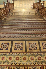 Minton tiles imported from England cover the grand staircase and upper gallery. The ground floor is tiled in basalt. The story goes: The ship bringing the tiles to Bombay capsized on the way, and hence the difference. Another tale claims the architects of the museum just ran out of Minton tiles.