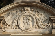 Relief sculpture of Queen Victoria and Prince Albert on the columned gateway to the museum.