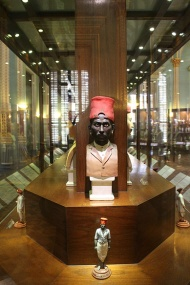 Much of an Indian's ethnicity is revealed by their headdress. Cognizant of this fact, the Headwear case is a magnificent record of the prevalent styles in the city of Mumbai during the late 19th and early 20th Centuries, highlighting its diversity and cosmopolitanism. The picture shows the bust and full length figure of a Koli. Kolis, farmers and fisherfolk by occupation, belong to one of the few aboriginal tribes of Dravidian origin. Their connection with Mumbai dates back to 150 AD.