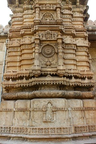 Ornamental bands of relief carvings cover the two minarets flanking the central arched entrance of Saher-ki-Masjid.