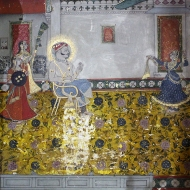 A dancing girl performs a mujra for the Maharao.