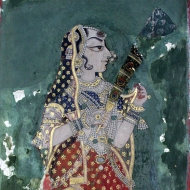 Bedecked in jewels and hennaed fingers, a Rajput woman gently holds her gossamer thin veil in one hand and a peacock feathered fan in the other.