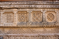 Stunning carvings—sacred, secular, and geometric—cover the walls and pillars of the seven-storeyed subterranean edifice. The above stone border is reminiscent of the Patola silk weaves which Patan is famous for.