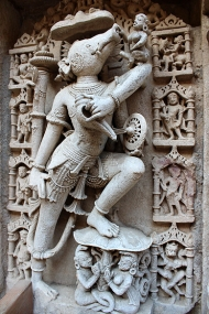 There are nearly 400 large sculptures carved into the stepwell's surfaces. This carving is of Varaha, an incarnation of Vishnu in which he is represented with a human body and boar's head. Note the sensuous goddess caressing Varaha's snout.