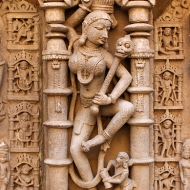 A female beggar with a club made from human bone capped by a skull—a common sight perhaps in medieval Gujarat.