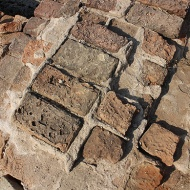 4,400-year-old bricks. Lothal was built around its port using the same plans and building materials as other Indus cities. The houses were constructed on sun-dried brick platforms, separated by streets laid out in a grid.