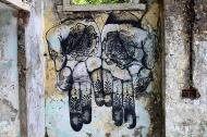 The third cluster of graffiti decorates Chaurasi Kutiya, an ensemble of 84 meditation huts. Watch out for Pan's ethereal hand mudras ...