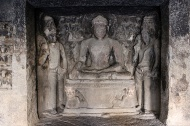 Eleven of the 12 caves are viharas or monasteries—rectangular, surrounded by monks' cells, and a sanctum at the back in which a serene Buddha sits flanked by two fly-whisk bearing Bodhisattvas. This is inside Cave 12.