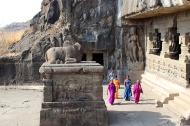 Nandi, Shiva's mount on a pedestal in Cave 21's courtyard. Though a designated archaeological site, Ellora is even now a sacred site for pilgrims of the three represented religions.