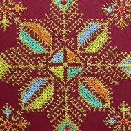 Meknes embroidery can be identified easily with its diagonal lines and tree and star-shaped motifs.