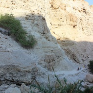 See those figures walking along a rocky shelf? It gives you an idea of the scale of Ein Gedi.