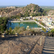 The view to climb up 615 steps for: Belagola, the white pond, with Chandragiri Hill sprinkled with ancient Jain temples.