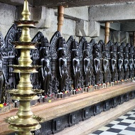 Bhandar Basadi with its 24 Jain Tirthankaras all lined up in a neat row inside its sanctum.
