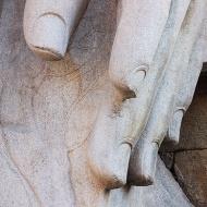 Detail, Bahubali's granite hand with fingernails and vine leaves.
